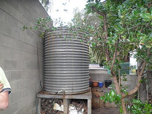 small circular water tank with small trees
