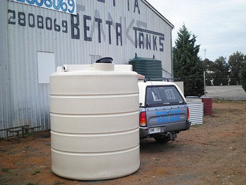 white water tank with a blue truck