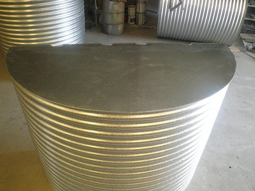 silver cylinder water tank