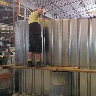 technician working on metal tank