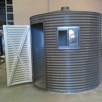 cylinder tank with opened door and window