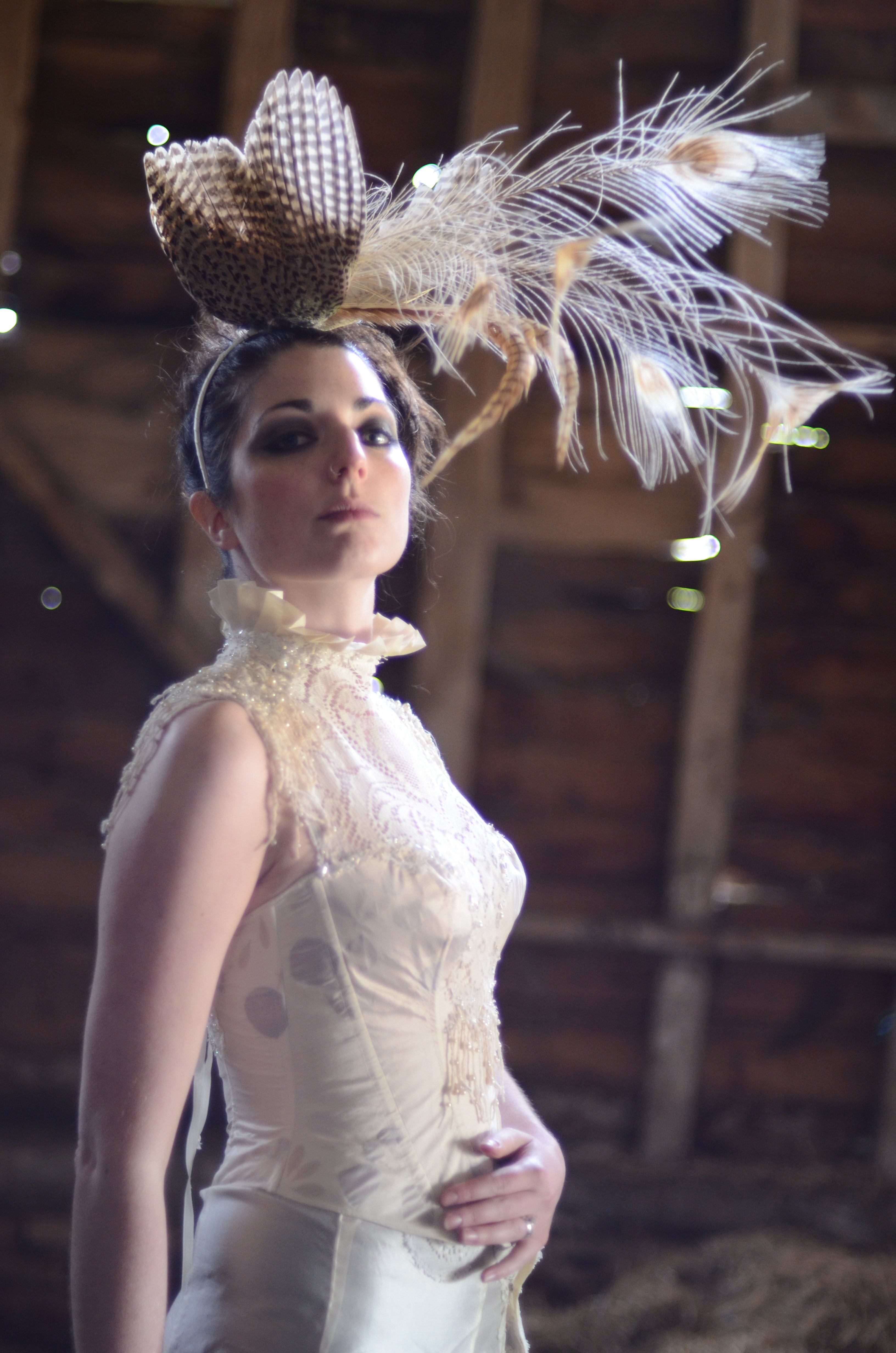 Alternative, historically inspired dress with real flower petals, albino peacock feathers