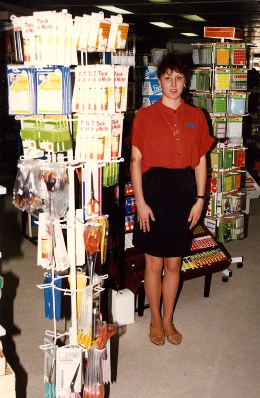 woman standing next to office equipment