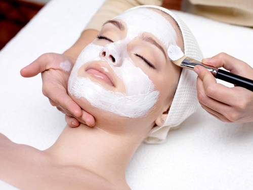 Woman getting a face mask for her skin in Anchorage