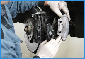 Image of brake pads being replaced