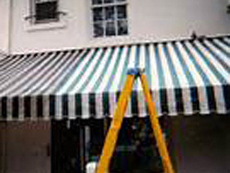 true value blind curtain cleaning and repair green white awning