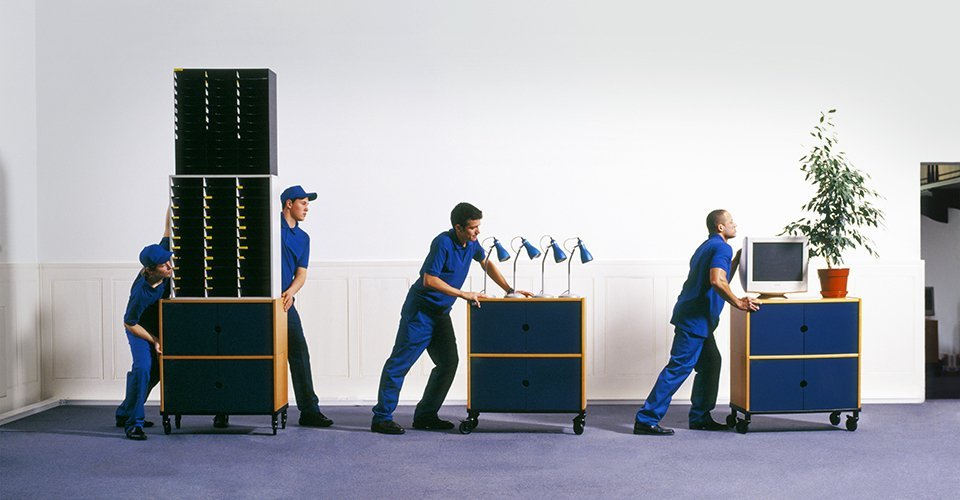 A team of removal men shifting office furniture