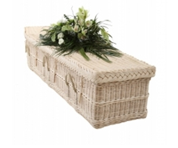 Cream color coffin with flowers
