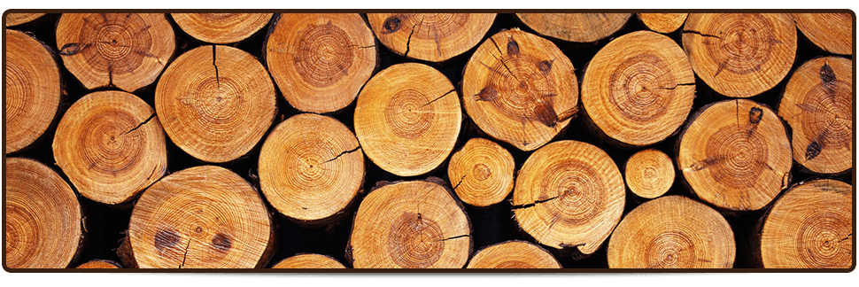 Stacked chopped seasoned logs beside contemporary fireplace setting
