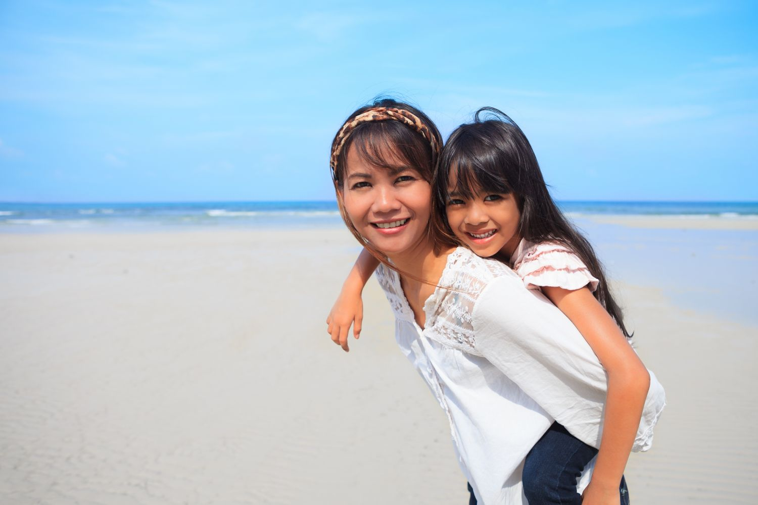 Dentist and assistant with young child, we specialize in family dentistry in Kailua, HI