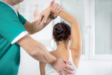 Chiroporatic care provided by therapist to patient's back.
