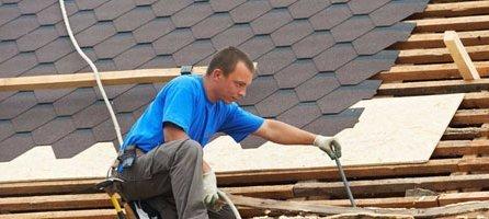 Man repairing house roofs