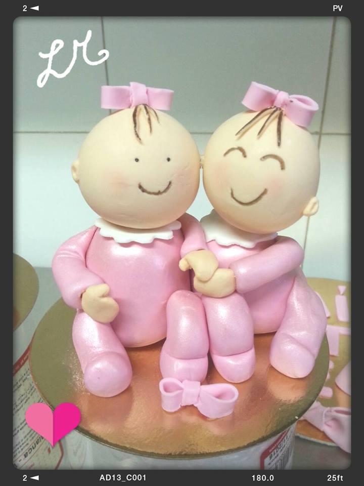 torta scultura a forma di bebé