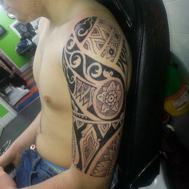 black coloured tattoo in arm