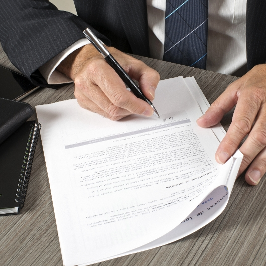 A lawyer signs a document