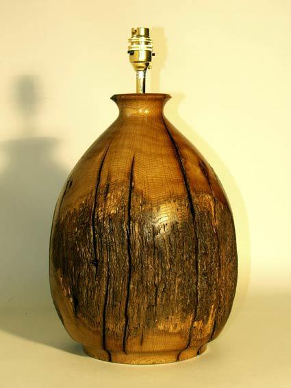 rustic oak old beam lamp,  bottled shaped reclaimed from old oak beams