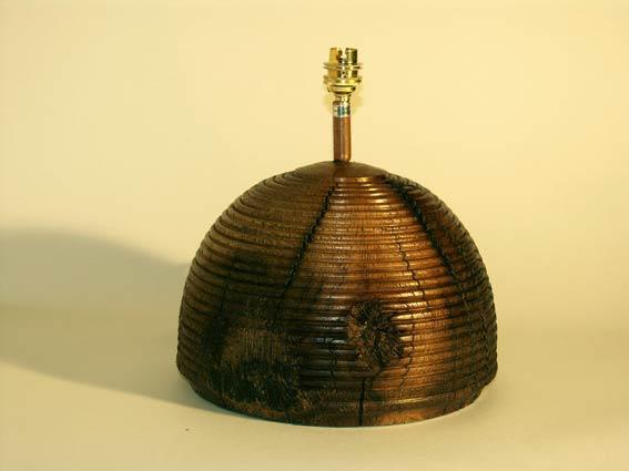 Rustic wooden beam lamp, beehive design.