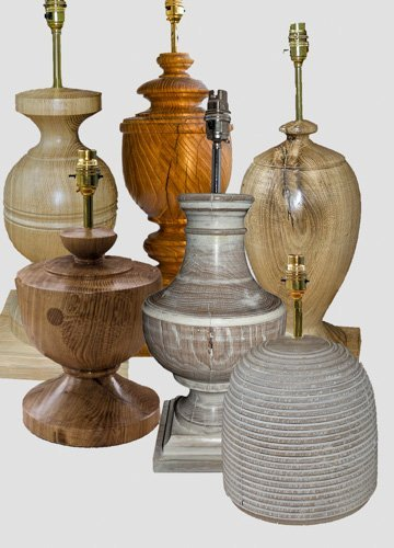 A selection of large classical shaped new Oak beam lamps.