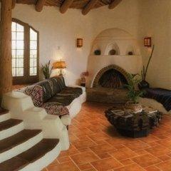 Pavimento Ariana Siena Rosso in un salotto