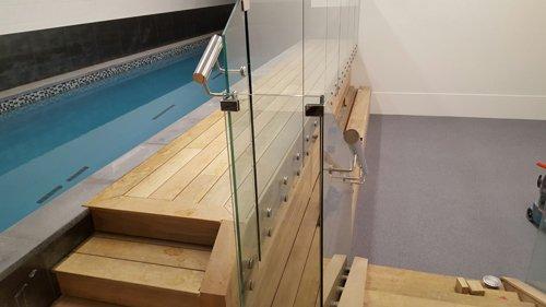 Pool side glass railing