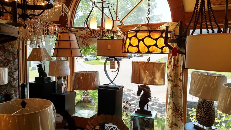 A Window View Of Some Hanging Lights And Lamps.
