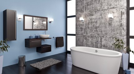 stylish blue and stone bathroom with floor standing bath