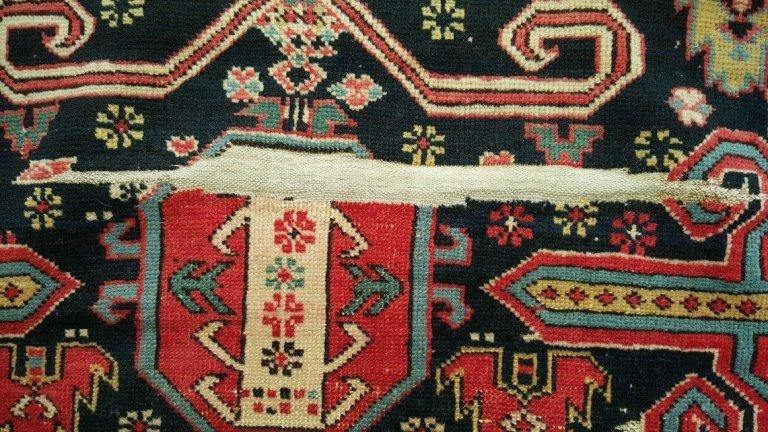 pirmo piano di un tappeto persiano