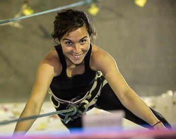 Women doing indoor rock climbing