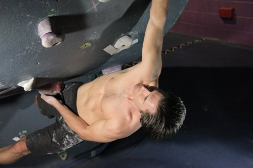Man doing Indoor Climbing