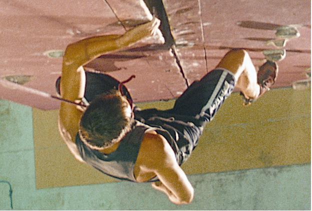 Man doing indoor rock climbing