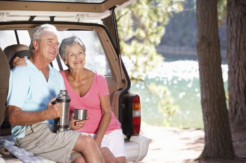 Happy Older Couple Enjoying A View At Campsite