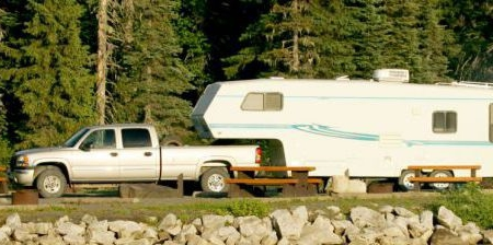 Truck Towing A Travel Trailer To Campsite