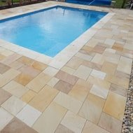 Swimming pool surrounded by paving