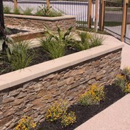 Stacked stone feature retaining wall
