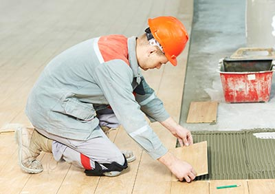 Tradesman laying tiles
