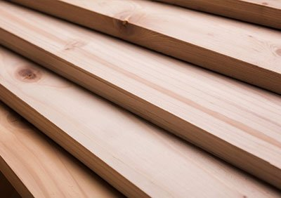 Planks of treated timber