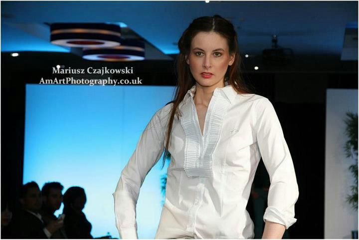 woman in white walking the ramp