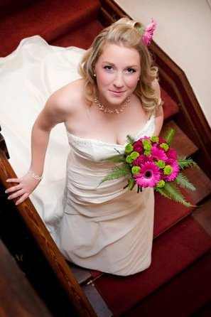 bride posing in stairway