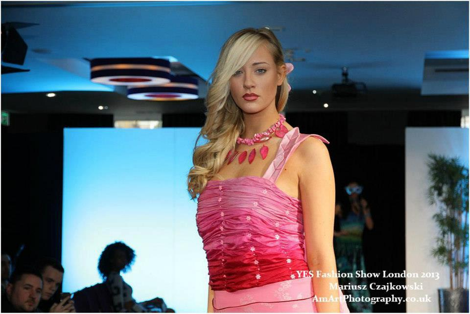 woman in pink walking the ramp