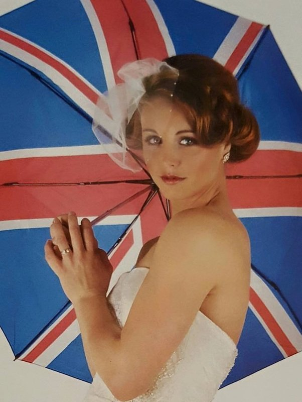 bride posing with flag umbrella