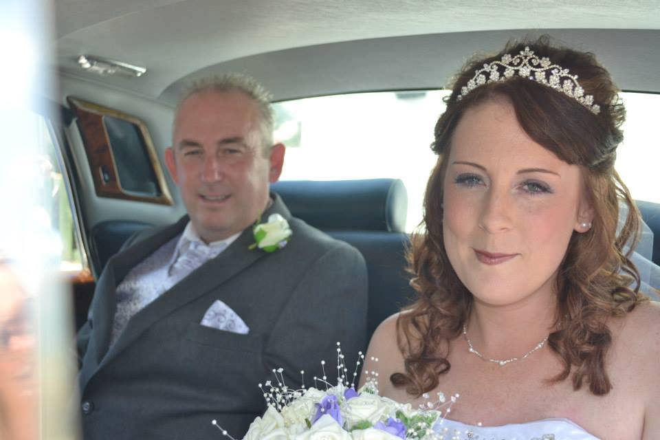 bride sitting in her car with her father