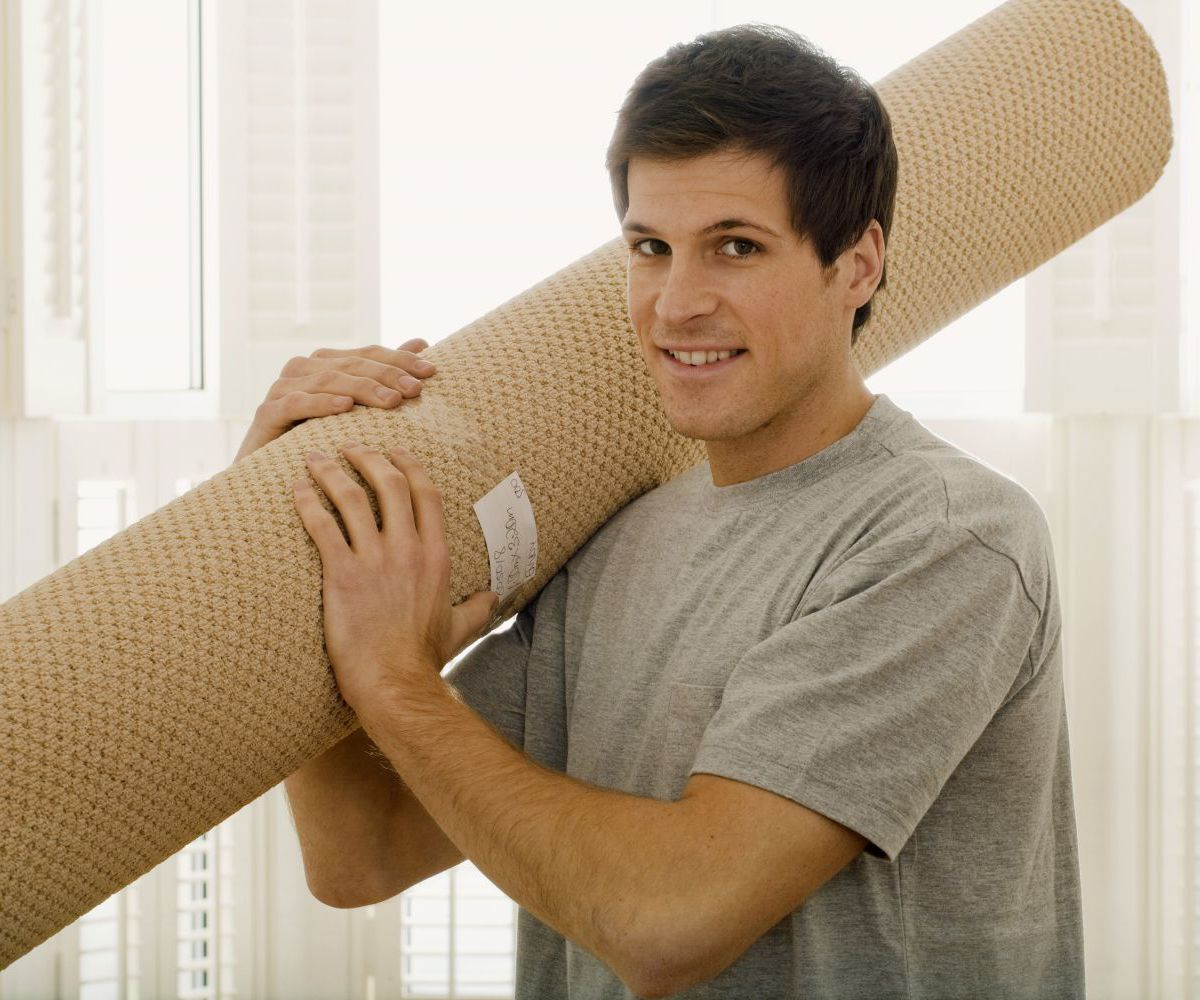 Man carrying a rug