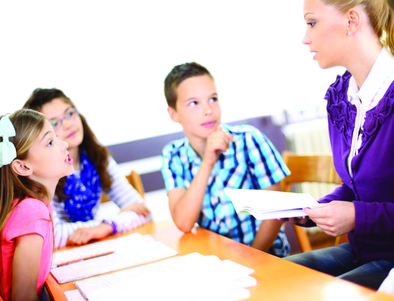tutor with small group of children
