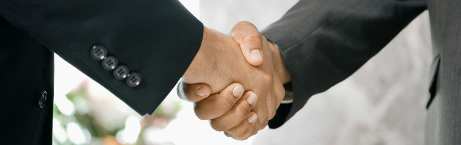 Lawyers in Auckland shaking hands