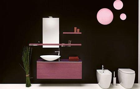 un bagno moderno con due lavabi e sotto un mobiletto viola