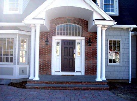 Boston Colonial Brick with a soldier course border and a Bluestone keystone.