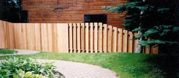 A cedar fence in front of a house in Anchorage