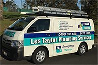 les taylor plumbing services business logo