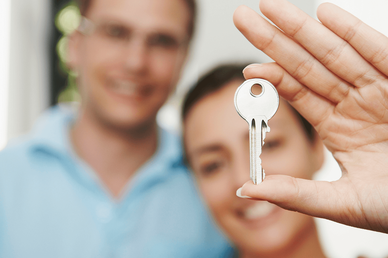 A couple with a key
