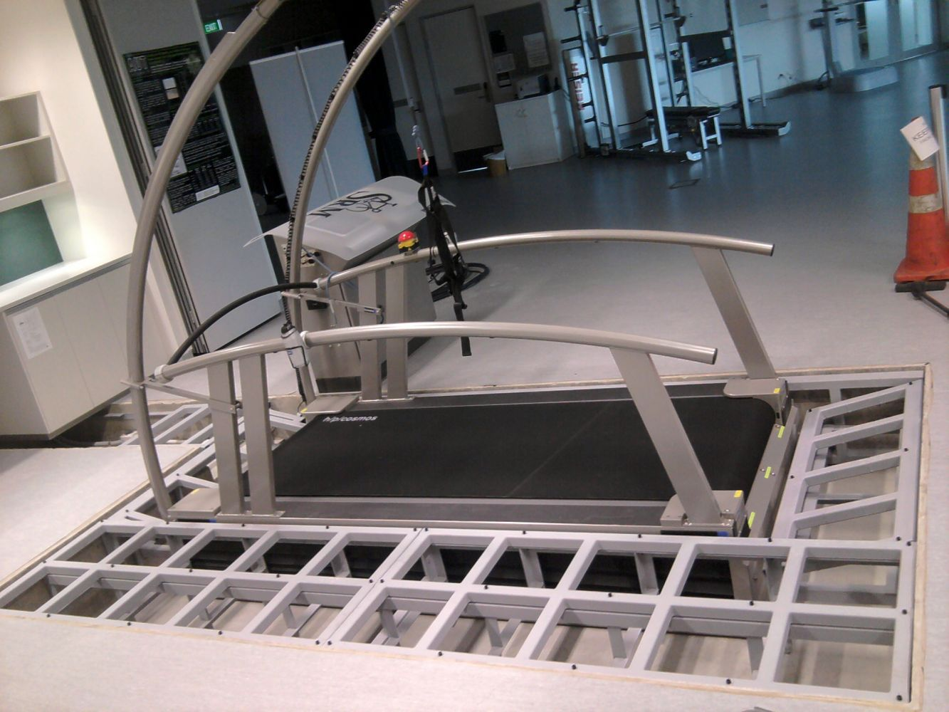 Steel frame surrounding a treadmill